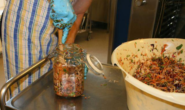 Packing vegetables in jars
